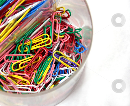 Clear Cup of Colored Paperclips stock photo, A clear cup is filled is brightly colored paperclips on a white background. by Valerie Garner