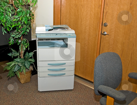 Office Area With Copy Machine stock photo, This is an office setting with a copy machine and artifical plant to the side. by Valerie Garner