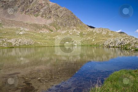 Alpine lake stock photo, Lago Strino is a small italian alpine lake in val di sole, Trentino. Photo taken with polarizer filter by ANTONIO SCARPI