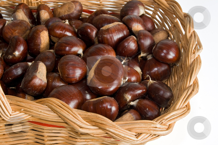 Basket with chestnuts stock photo, wicker basket with chestnuts isolated on white background by ANTONIO SCARPI