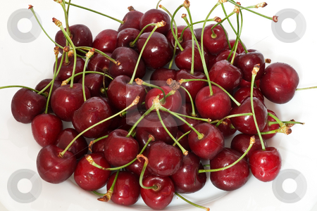 Ripe cherries stock photo, A group of ripe cherries on o white plate by ANTONIO SCARPI