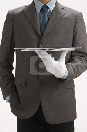 Sale person holding a tray stock photo, Asale person holding a  sliver empty tray by eskaylim