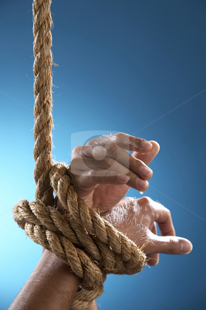 Hand tight by rope stock photo, Hand being tight by rope asking for help by eskaylim