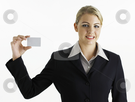 Young businesswoman holding card stock photo, Young business woman holding card looking at camera by eskaylim