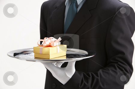 Saleman holding a sliver tray with  gift stock photo, Saleman holding a sliver tray with  gift by eskaylim