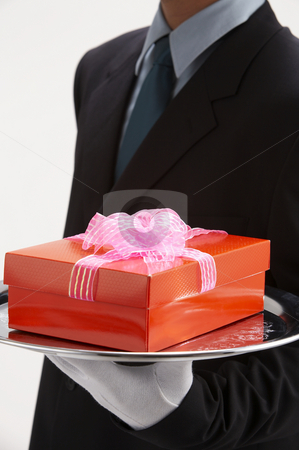 Man holding a present stock photo, Man holding exclusive presents to someone special by eskaylim