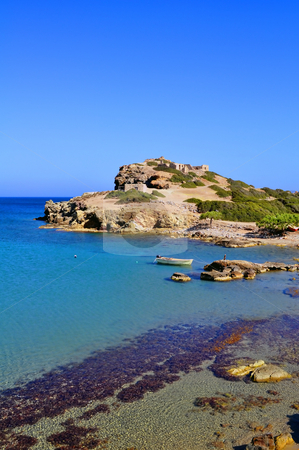 Fantastic view of a boat on the east coast of Crete stock photo, Travel photography: View of the Mediterranean Sea and east coast of Crete by Fernando Barozza