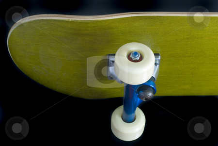 Skateboard trucks stock photo, Underside of a skateboard deck with blue metallic trucks by Stephen Gibson