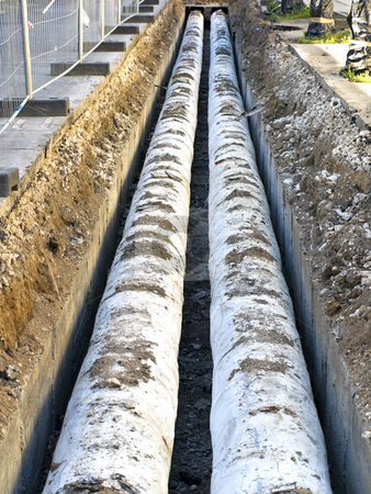 Pipes  stock photo, Two water pipes in the trench by Sergej Razvodovskij