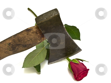 Rose and axe stock photo, Rose and axe at the white table by Sergej Razvodovskij