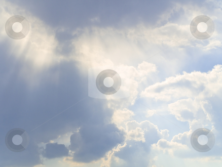 Sunshine  stock photo, Sunshine through the clouds in the blue sky by Sergej Razvodovskij