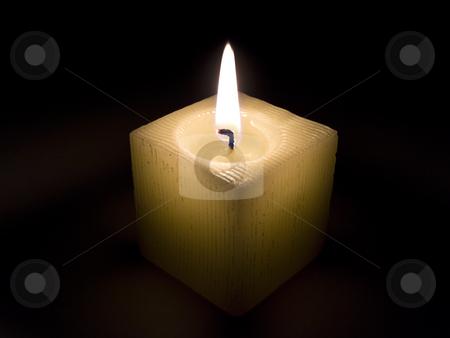 Candle  stock photo, Single burning candle in the dark night by Sergej Razvodovskij