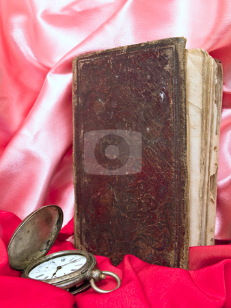 Book  stock photo, Old book with old clocks against the pink and red textile by Sergej Razvodovskij