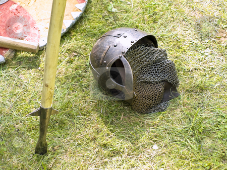 Helmet stock photo, Knight metal helmet, pike and shield at the green grass by Sergej Razvodovskij