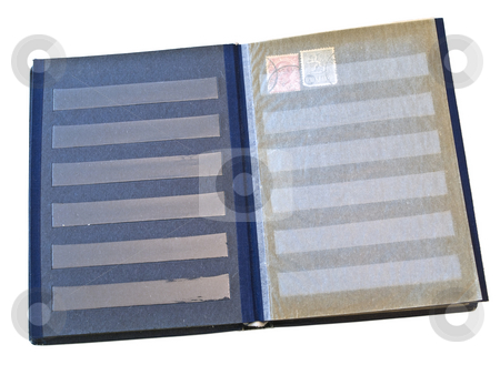 Album  stock photo, Isolated stamp album with some stamps against the white background by Sergej Razvodovskij
