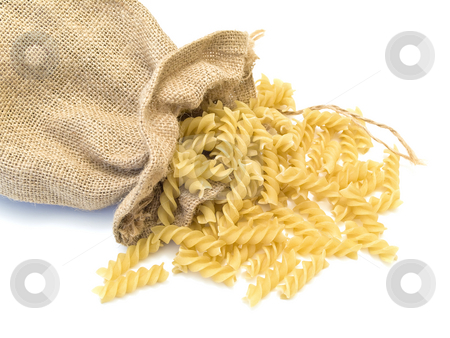 Pasta  stock photo, Sack of pasta at the white table by Sergej Razvodovskij