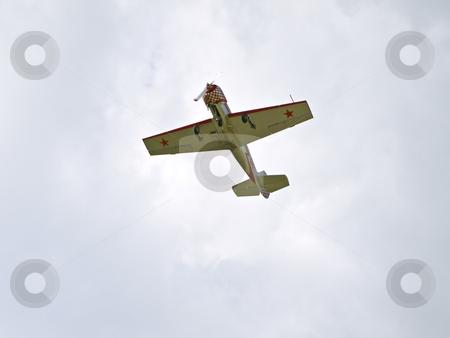 Aeroplane  stock photo, Single sport aeroplane flying in the blue sky by Sergej Razvodovskij