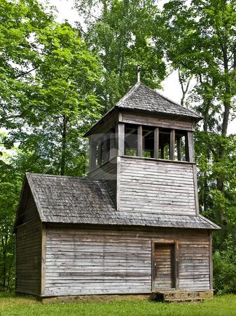 Chapel  stock photo, Old wooden chapel in the forest by Sergej Razvodovskij