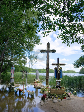 Roods  stock photo, Pilgrimage place with the roods in the water by Sergej Razvodovskij