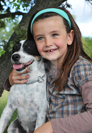 Little girl and dog stock photo, Smiling little girl and her jack russel terrrier by Bonzami Emmanuelle
