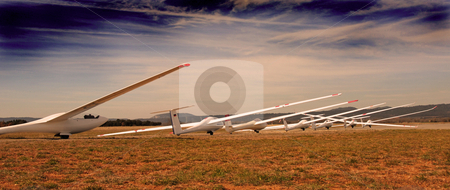 Gliders in evening stock photo, Seven white gliders in an aerodrome in south of France by Bonzami Emmanuelle