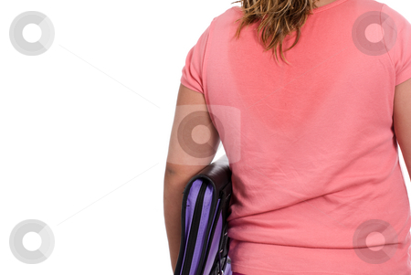 Back To School stock photo, Closeup of a young girl with wet hair, holding a binder and walking away from the camera, isolated against a white background by Richard Nelson