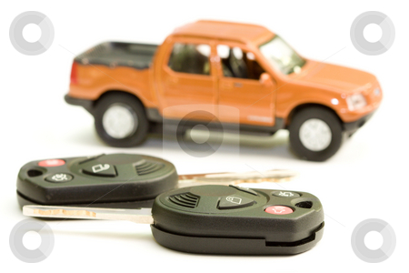 Car key  stock photo, Macro picture of car key with truck as the background by Hieng Ling Tie