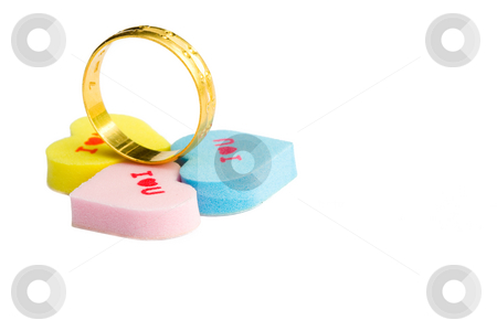 Wedding ring stock photo, Gold wedding ring with three l love you heart shape by Hieng Ling Tie