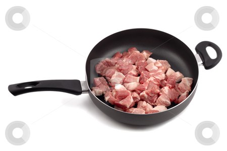 Meat raw in frying pan stock photo, Meat raw in frying pan isolated on white background by Vladyslav Danilin