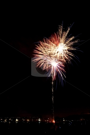 4th Fireworks stock photo, Firework is a low explosive pyrotechnic device used primarily for aesthetic and entertainment purposes. by Mariusz Jurgielewicz