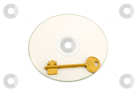 Golden key on compact disk stock photo, Golden key on compact disk isolated on white background by Vladyslav Danilin