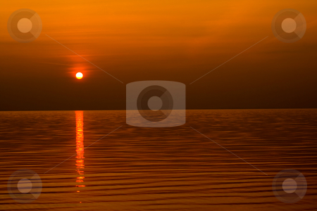 Sundown scene  stock photo, Sundown scene with dark clouds and rays over sea. background, wallpaper. by Vladyslav Danilin