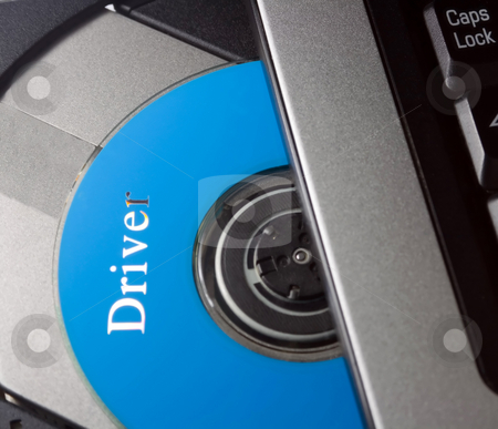 Laptop with driver disc stock photo, Laptop with open CD holder , driver disc by Vladyslav Danilin