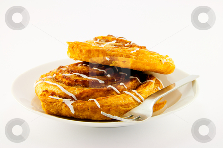 Cinnamon Buns and Fork stock photo, Two cinnamon buns on a plate with a fork with a  clipping path on a white background by Keith Wilson