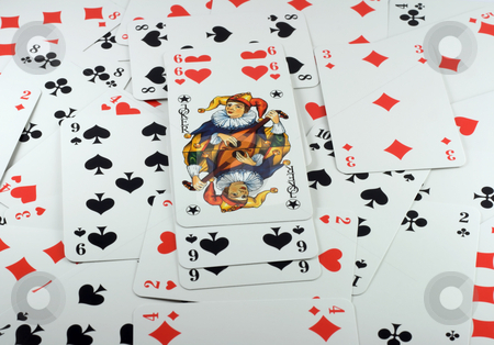 Six beside Joker stock photo, Poker cards background, with six beside Joker. by Vladyslav Danilin
