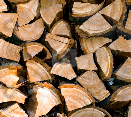 Firewood stock photo, Chopped and stacked firewood background by Vladyslav Danilin