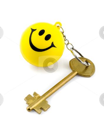 Golden key stock photo, Golden key on key ring smiles isolated on white background by Vladyslav Danilin