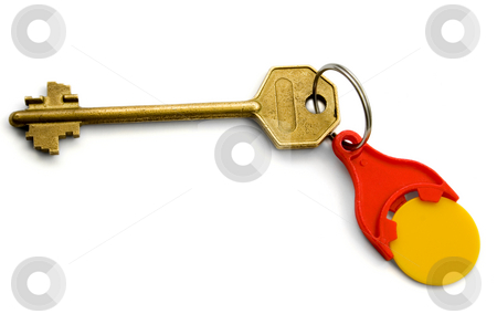 The Key with red key ring for coins stock photo, Isolated bronze Key with red key ring for coins On White  background by Vladyslav Danilin