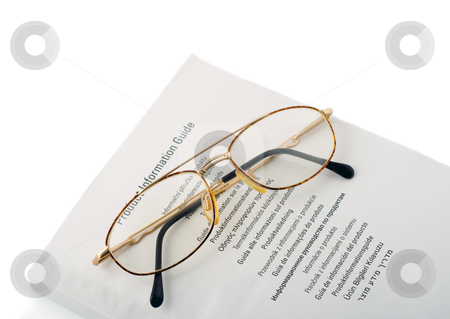 Spectacles in book stock photo, Spectacles in book instruction isolated on white background by Vladyslav Danilin