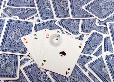 Four Aces stock photo, Four Aces in  Background scattered Playing Card Back  . by Vladyslav Danilin