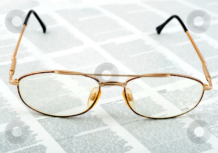 Eyeglasses stock photo, Eyeglasses golden on text background by Vladyslav Danilin