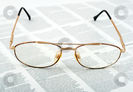 Eyeglasses golden  stock photo, Eyeglasses golden on text background. by Vladyslav Danilin