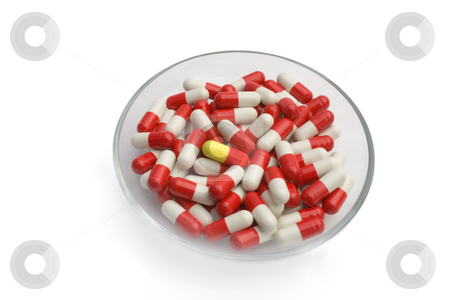 Red and white capsules  stock photo, Red and white capsules ,Isolated on white background. by Vladyslav Danilin