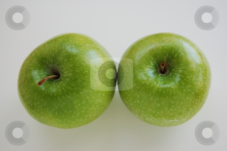 Apple Duo stock photo, Two green apples sitting on isolated white background. by Tina Kim