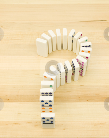Domino question Mark stock photo, Domino question mark on a wooden background by John Teeter