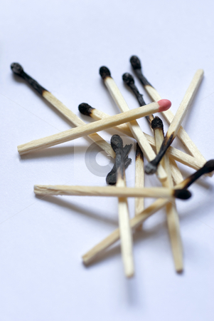Odd one out stock photo, A pile of burnt matches with one head still unburned by Stephen Gibson