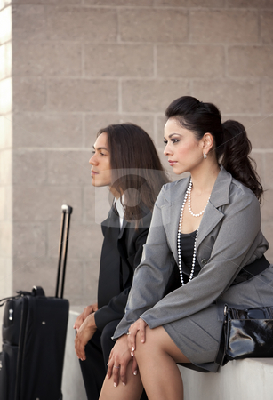 Travelers stock photo, Handsome man and pretty woman at airport or station by Scott Griessel
