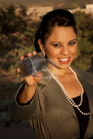Pretty young woman with small solar panel stock photo, Pretty young woman with small solar panel in hand by Scott Griessel