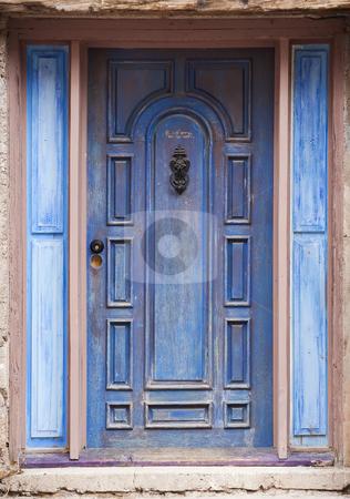 Old Blue Door stock photo, Old peeling blue door with metal knocker by Scott Griessel