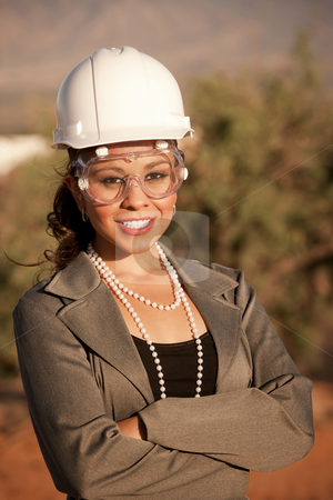 Young woman in hard hat and safety goggles stock photo, Pretty young woman in hard hat and safety goggles by Scott Griessel